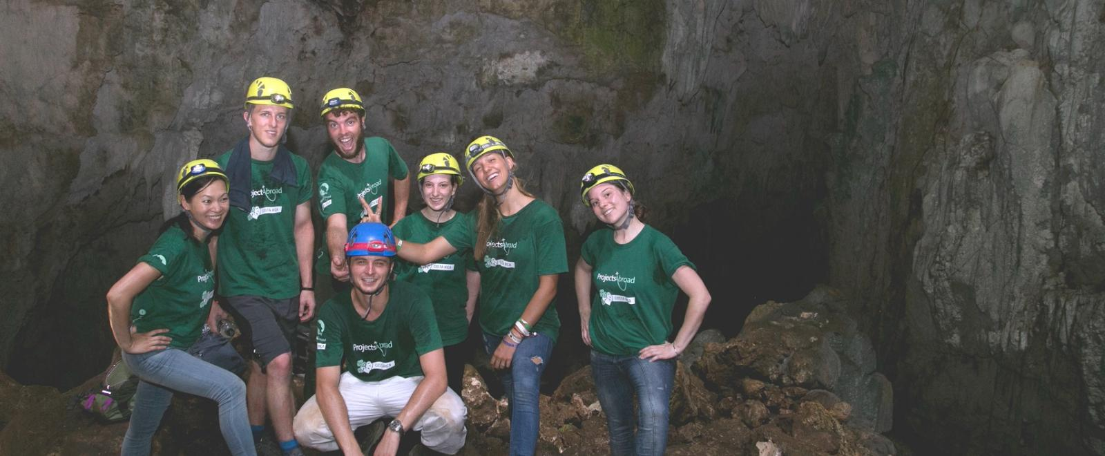 A group of Projects Abroad volunteers do conservation work within the caves of Costa Rica